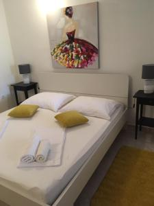 A bed or beds in a room at Vila Mozara