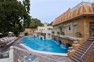 The swimming pool at or near The Ajit Bhawan - A Palace Resort