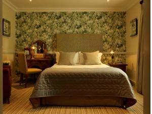 A bed or beds in a room at Wentbridge House Hotel