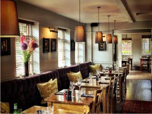 A restaurant or other place to eat at The Black Horse Fulmer