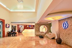 منطقة الاستقبال أو اللوبي في Flora Airport Hotel and Convention Centre Kochi