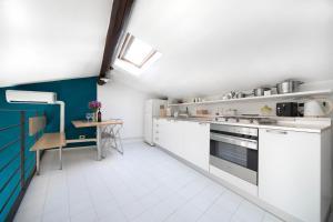 A kitchen or kitchenette at D'Azeglio Halldis Apartments