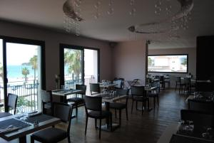 Restaurant ou autre lieu de restauration dans l'établissement Appart'hôtel Le Dauphin