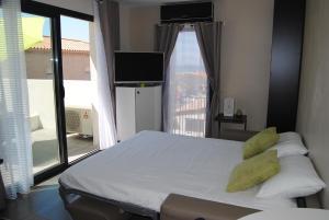 Un ou plusieurs lits dans un hébergement de l'établissement Appart'hôtel Le Dauphin