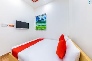 A bed or beds in a room at M&C Hotel Nha Trang
