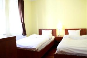 A bed or beds in a room at Hotel Vera