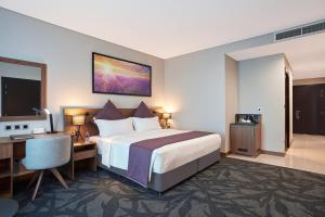 A bed or beds in a room at Park Regis Business Bay