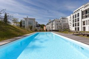 The swimming pool at or near FIRST SELLIN Appartement 33