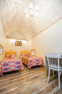 Кровать или кровати в номере Boutique Hotel Minzifa