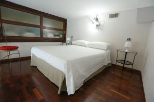A bed or beds in a room at B&B MALATERRA by Dimorra