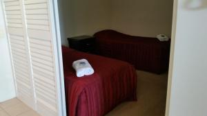 A bed or beds in a room at Grand Hotel Ocean view Apartment Labrador
