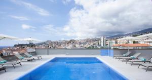 The swimming pool at or near TURIM Santa Maria Hotel