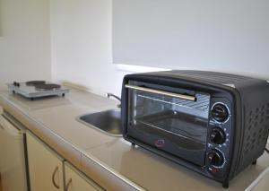 Una cocina o kitchenette en La Fleur