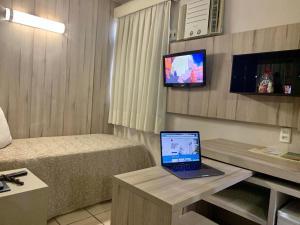 A television and/or entertainment center at Samburá Praia Hotel