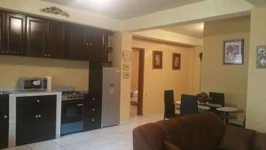 A kitchen or kitchenette at Apart Hotel, Ceiba
