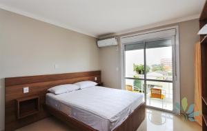 A bed or beds in a room at Residencial Bela Morada
