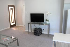 A television and/or entertainment center at Willow Island - Waterfront