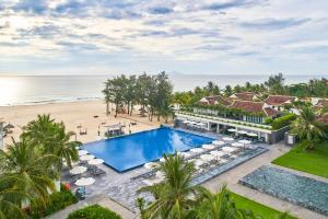 A view of the pool at Pullman Danang Beach Resort or nearby