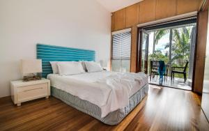 A bed or beds in a room at Noosa Residences