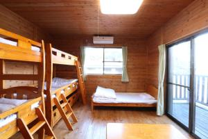 A bunk bed or bunk beds in a room at Maetakeso