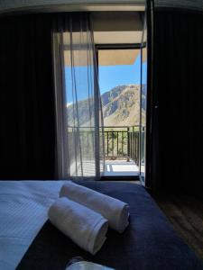 A bed or beds in a room at Hotel Gold Kazbegi