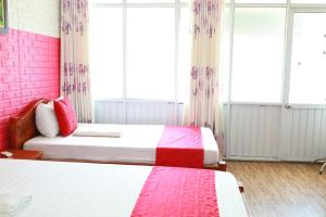 A bed or beds in a room at Thức at 3am