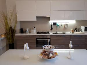 A kitchen or kitchenette at Casa Massima Suites