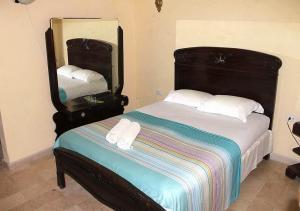 A bed or beds in a room at Casa Alejandra TRINIDAD