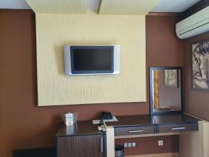 A television and/or entertainment center at Hotel Gabi