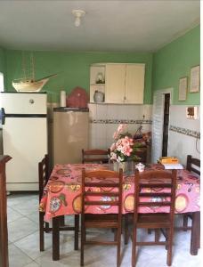 A kitchen or kitchenette at Casa na Ilha