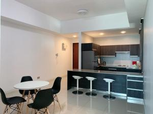 A kitchen or kitchenette at Bay Resort Condominium, 7, Beach-front Sea view, 6-8 PAX