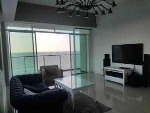 A seating area at Bay Resort Condominium, 7, Beach-front Sea view, 6-8 PAX