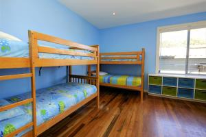 A bunk bed or bunk beds in a room at YALLUMBEE