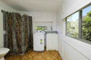 A kitchen or kitchenette at TRADEWINDS