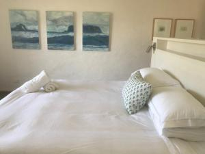 A bed or beds in a room at AMANZI