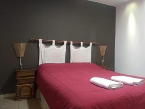 A bed or beds in a room at Dptos el parque