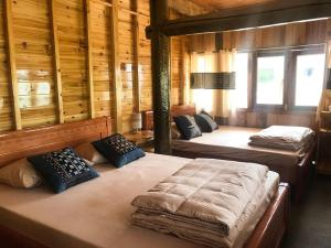 A bed or beds in a room at PoMu House Homestay