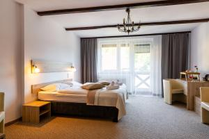 Łóżko lub łóżka w pokoju w obiekcie Hotel Ariston