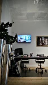 A television and/or entertainment center at Bohemian Suites Athens