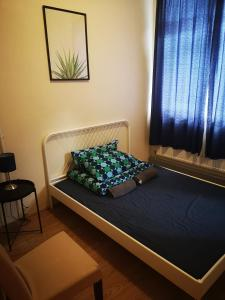 A bed or beds in a room at Birmingham Central Backpackers