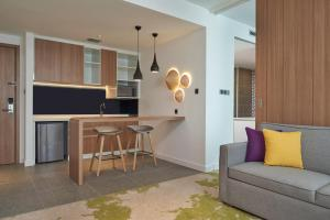 A kitchen or kitchenette at Holiday Inn & Suites Saigon Airport