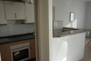 Een keuken of kitchenette bij Apartamentos El Sombrero