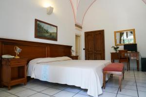 Letto o letti in una camera di Masseria Appidé