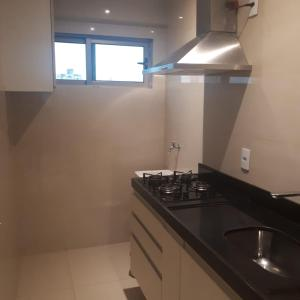 A kitchen or kitchenette at Praia Calma Premium Flat