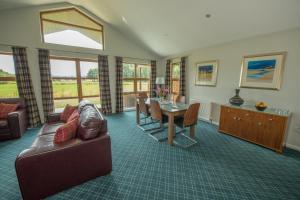 A seating area at Loch Lomond Waterfront Luxury Lodges