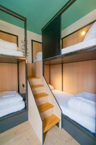 A bunk bed or bunk beds in a room at Sparks Hostel