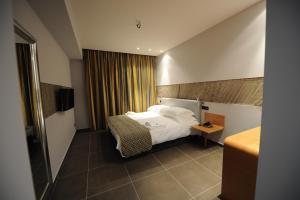 Ένα ή περισσότερα κρεβάτια σε δωμάτιο στο Hotel Iliana