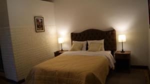 Cama o camas de una habitación en Cusco Hostel Inti