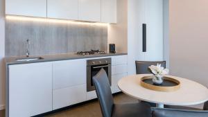 A kitchen or kitchenette at Avani Melbourne Central Residences