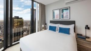 A bed or beds in a room at Avani Melbourne Central Residences